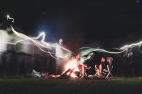 Playing with light effects around the campfire.