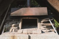 Enjoy the weekly pizza night with pizza cooked in an outdoor brick oven.