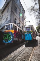 Lisbon is renown for its hilly terrain and trolley cars.