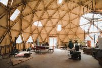 The geodesic dome (with a passive solar design) serves as the community gathering area. It is the future home of a shared kitchen and bathroom.