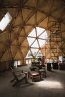 The geodesic dome (with a passive solar design) serves as the community gathering area. It is the future home of a shared kitchen and bathroom..