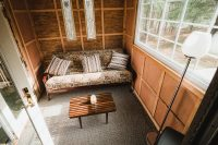 The Ravens Nest living area opens onto the deck overlooking the pond.