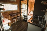 Can you believe this? The Ravens Nest not only has electric and hot water but also has a kitchenette with sink, stove, coffee maker, propane grill, and breakfast bar. Perfect to sit at and gaze outside at the pond.