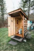 The lower level of the property has a gorgeous bathroom. You simply can't call this an outhouse.